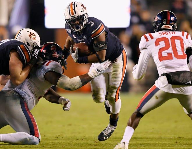 Auburn running back D.J. Williams (3) carries the ball against Ole Miss on Saturday, Nov 2, 2019 in Auburn, Ala.