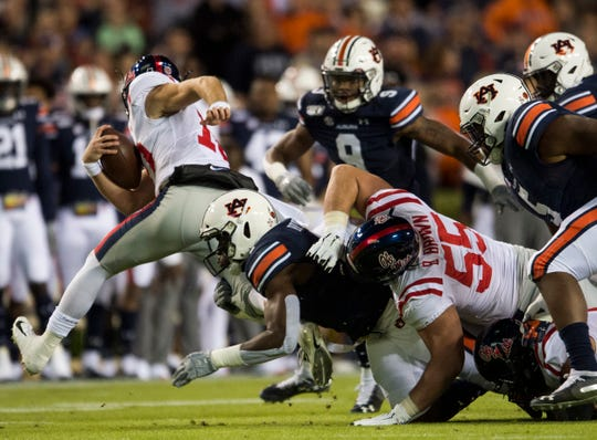 Ole Miss quarterback John Rhys Plumlee (10) is tackled by Auburn defensive lineman Big Kat Bryant (1) at Jordan-Hare Stadium in Auburn, Ala., on Saturday, Nov. 2, 2019. Auburn leads Ole Miss 10-7 at halftime.