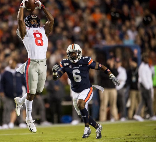 Ole Miss wide receiver Elijah Moore (8) catches a pass at Jordan-Hare Stadium in Auburn, Ala., on Saturday, Nov. 2, 2019. Auburn leads Ole Miss 10-7 at halftime.