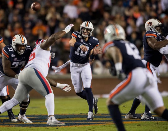 Auburn quarterback Bo Nix (10) throws the ball to Auburn running back Jay Jay Wilson (42) at Jordan-Hare Stadium in Auburn, Ala., on Saturday, Nov. 2, 2019.