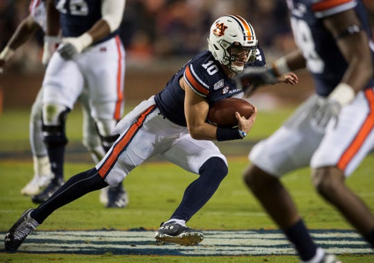 Auburn quarterback Bo Nix (10) runs the ball at Jordan-Hare Stadium in Auburn, Ala., on Saturday, Nov. 2, 2019. Auburn leads Ole Miss 10-7 at halftime.
