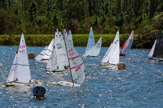 Eighteen sailors from eight different states race their Star 45 class model yachts during Star 45 National Championship at the lake in North Collier Regional Park in Naples, Florida Sunday, Nov. 3, 2019. American Model Yachting Association (AMYA) hosts the three-day 17 rounds race, Naples Model Yacht Club sponsored this year's championship.