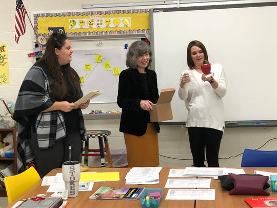 Amy Cox (right), literacy coordinator at Newark's Hillview Elementary, reacts to her Leaders for Learning award received Thursday from the Licking County Foundation.