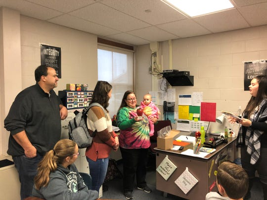 Traci Lausberg, holding her granddaughter Sloan, received the Leaders for Learning award in her Licking Valley Middle School classroom from the Licking County Foundation Thursday as her family watches. She teaches seventh grade language arts.
