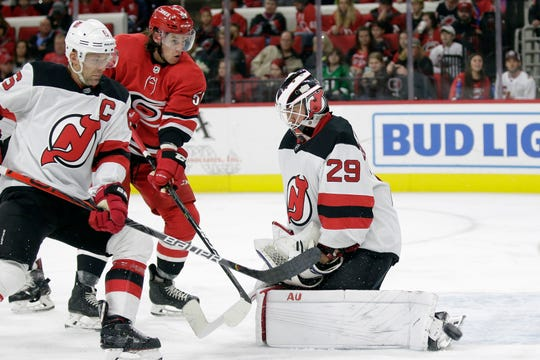 New Jersey Devils goaltender Mackenzie Blackwood (29) and defenseman Andy Greene (6) defend the goal against Carolina Hurricanes left wing Erik Haula (56), of Finland, during the second period of an NHL hockey game in Raleigh, N.C., Saturday, Nov. 2, 2019.