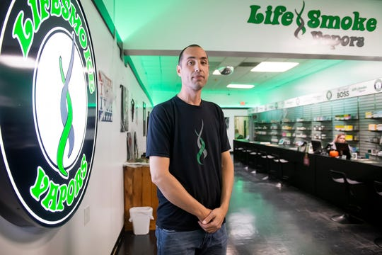 Michael Curry, owner of LifeSmoke Vapors, poses for a photo inside the North Hanover Mall location in late October. LifeSmoke Vapors has five locations in Pennsylvania and one in Maryland.