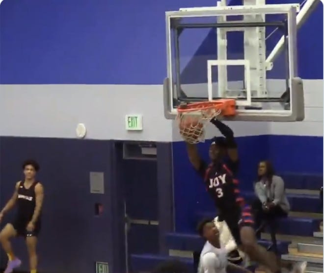 Nov. 2, 2019: Dream City Christian prep basketball guard Jalin Anderson finishes a fast break with a two-handed dunk as Sierra Canyon (Chatsworth, CA) guard Bronny James looks on.
