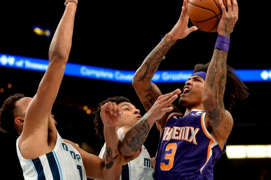 Phoenix Suns forward Kelly Oubre Jr. (3) shoots against Memphis Grizzlies forwards Brandon Clarke, center, and Kyle Anderson (1) in the second half of an NBA basketball game Saturday, Nov. 2, 2019, in Memphis, Tenn. (AP Photo/Brandon Dill)