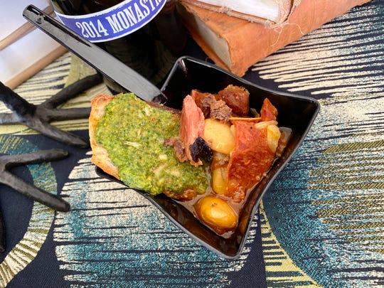 Fabada Asturiana with Iberico leg stock, chorizo, morcilla, saffron, pimenton and rapini pesto crostino from Talavera at the 2019 azcentral Wine & Food Experience at Salt River Fields near Scottsdale.