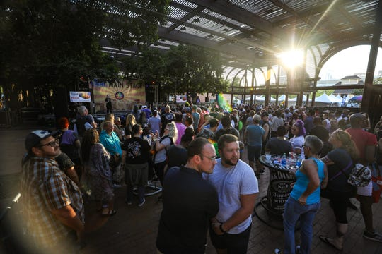 Festival attendees await a performance at the Bud Light Main State during the 18th annual Rainbows Festival on Nov. 2, 2019, in downtown Phoenix.