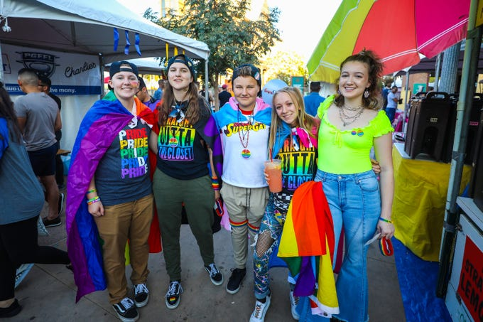 Festival attendees smile during the 18th annual Rainbows Festival on Nov. 2, 2019, in downtown Phoenix.