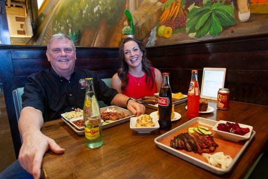 Tad Peelan, co-owner of Joe's Real BBQ, sits with Shandee Chernow Oct. 21, 2019. Joe's Real BBQ is one of the restuarants that have made their menu available on the CertiStar software. Carly Bowling/The Republic.