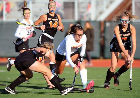 Palmyra's Lauren Wadas (21) moves between two East Pennsboro defenders during second half action.