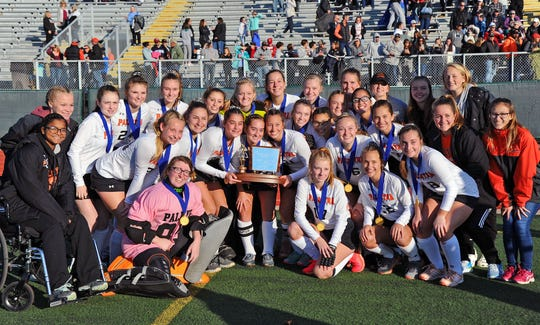 The Palmyra Cougars 2019 District III 2A field hockey champions.