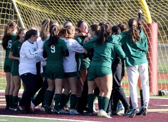 Pleasantville celebrates after defeating Bronxville 3-0 in the Section 1 Class C girls soccer championship at Arlington High School Nov. 3, 2019.