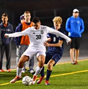 Central Dauphin's Alex Hanna, left, and Dallastown's Kyle Reuter battle for control of the ball during PIAA District 3, Class 4-A soccer championship action at Hersheypark Stadium in Hershey, Saturday, Nov. 2, 2019. Central Dauphin would win the game 1-0. Dawn J. Sagert photo