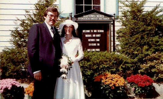 Michael, left, and Nancy Gotwalt stand outside the Maytown Church. The couple was married in their new home in 1982, before the sanctuary was remodeled into a living room.