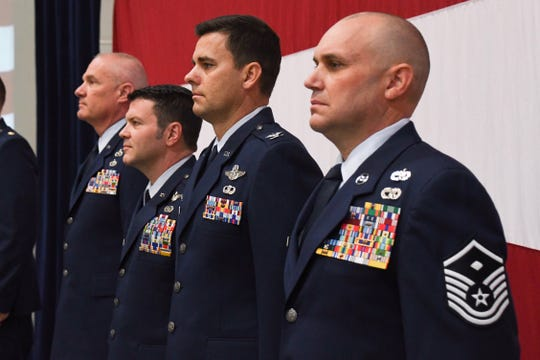 Col. Eric Wade (second to left) and Col. Jacob Hammons (second to right) stand together at a change-in-command ceremony at the Nevada Air National Guard base on Saturday, Nov. 2, 2019.