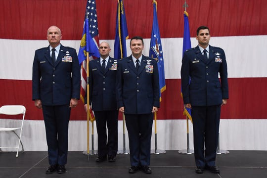 Col. Eric Wade (middle) and Col. Jacob Hammons (right) stand together at a change-in-command ceremony at the Nevada Air National Guard base on Saturday, Nov. 2, 2019.