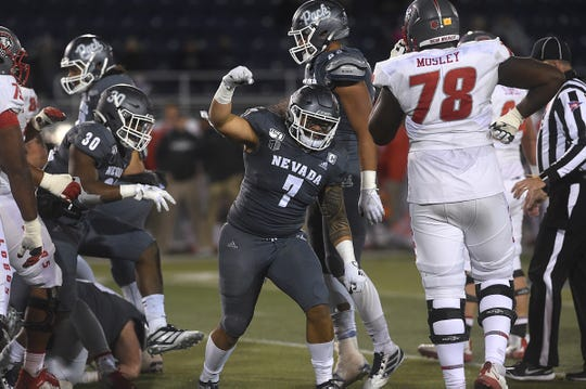 Nevada's Gabriel Sewell (7) celebrates a fourth-down stop against New Mexico on Saturday night.