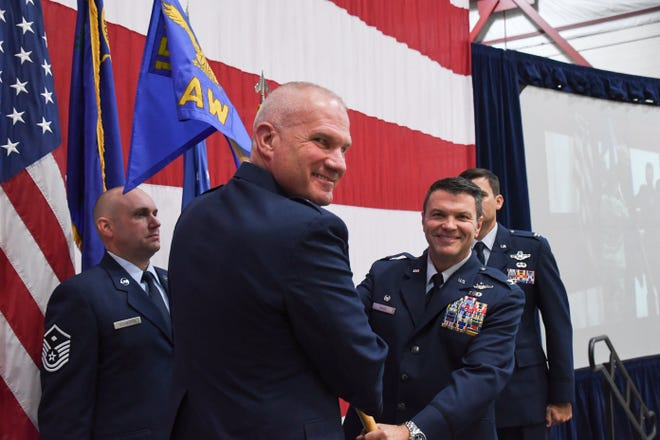 Brig. Gen. Glen Martel shakes Col. Eric Wade's hand at a change-in-command ceremony at the Nevada Air National Guard base on Saturday, Nov. 2, 2019.
