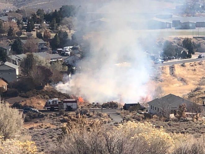 A fire burns near Westergard Elementary School on Sunday Morning, Nov. 3, 2019.