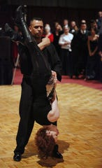 2010 file photo: RPD officer Manny Ortiz lifts his partner Megan Seely from the Arthur Murray Dance Studio during the Dancing With The Law competition at the 2010 Policeman's Ball. The event was modeled after Dancing With The Stars. Proceeds benefited The Badge of Honor Association and The Autism Council of Rochester.