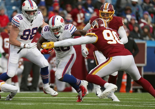 Bills running back Devin Singletary tries to beat Redskins Montez Sweat.