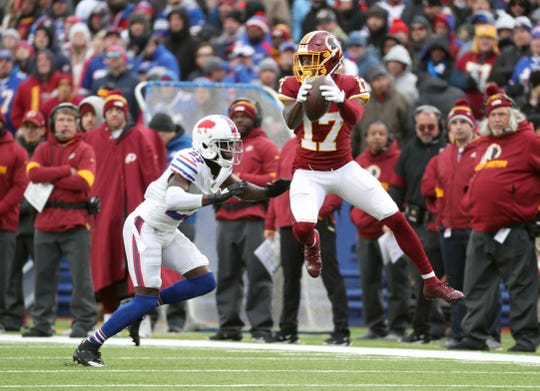 Redskins receiver Terry McLaurin catches a ball in front of Bills Tre'Davious White.
