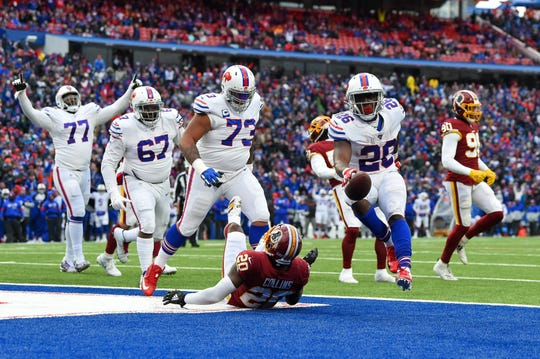 Nov 3, 2019; Orchard Park, NY, USA; Buffalo Bills running back Devin Singletary (26) leaps into the end zone for a touchdown past Washington Redskins strong safety Landon Collins (20) during the fourth quarter at New Era Field. Mandatory Credit: Rich Barnes-USA TODAY Sports