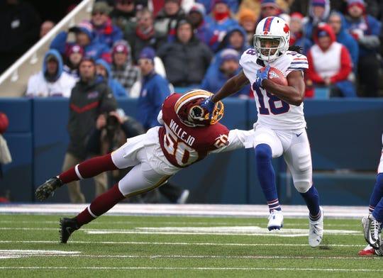Bills kick returner Andre Roberts breaks a tackle for a  66-yard kickoff return against the Redskins.