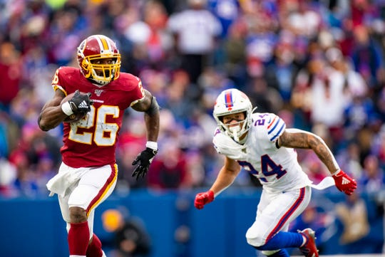 ORCHARD PARK, NY - NOVEMBER 03:  Adrian Peterson #26 of the Washington Redskins carries the ball for a first down during the second quarter against the Buffalo Bills at New Era Field on November 3, 2019 in Orchard Park, New York.  (Photo by Brett Carlsen/Getty Images)