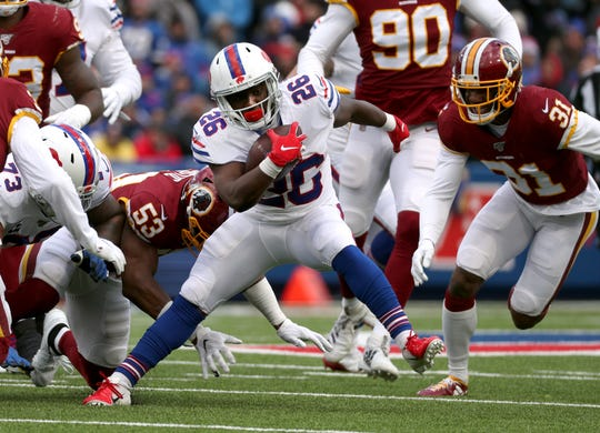 Bills running back Devin Singletary finds running room against the Redskins in the first half.