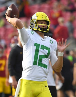 Oregon Ducks quarterback Tyler Shough warms up before last year's 56-24 win against the USC Trojans at the Los Angeles Memorial Coliseum.