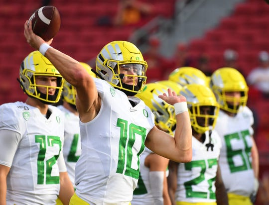 Nov 2, 2019; Los Angeles, CA, USA;   Oregon Ducks quarterback Justin Herbert (10) warms up before the game against the USC Trojans at Los Angeles Memorial Coliseum. Mandatory Credit: Jayne Kamin-Oncea-USA TODAY Sports