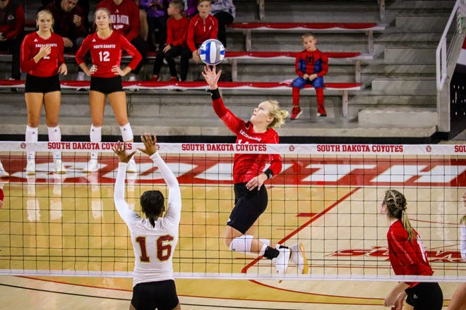 South Dakota outside hitter/defensive specialist Lolo Weideman hits the ball against Denver on Nov. 3, 2019 at the Sanford Coyote Sports Center in Vermillion, S.D.