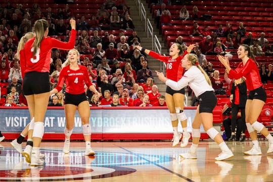 South Dakota volleyball team celebrates a point against Denver on Nov. 3, 2019 at the Sanford Coyote Sports Center in Vermillion, S.D.