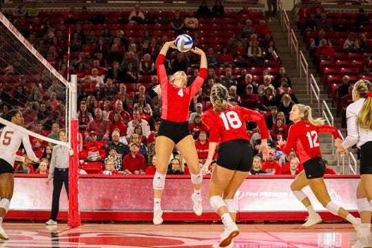 South Dakota outside hitter Elizabeth Loschen (12), middle blocker Maddie Wiedenfeld (18) and defensive specialist Anne Rasmussen (right) look on as setter Madison Jurgens (4) sets the ball against Denver on Nov. 3, 2019 at the Sanford Coyote Sports Center in Vermillion, S.D.