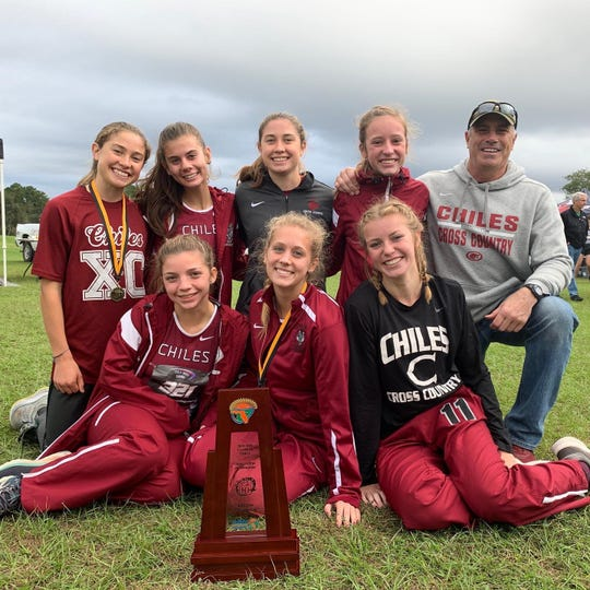 Chiles' girls cross country team captured a Region 1-4A title on Saturday in Gainesville. Bottom, from left: Ashley Murphy, Caitlin Wilkey, Emily Molen; Top, from left: Alyson Churchill, Ella Hodges, Megan Churchill, Kelly Davis, coach Mike Phillips.