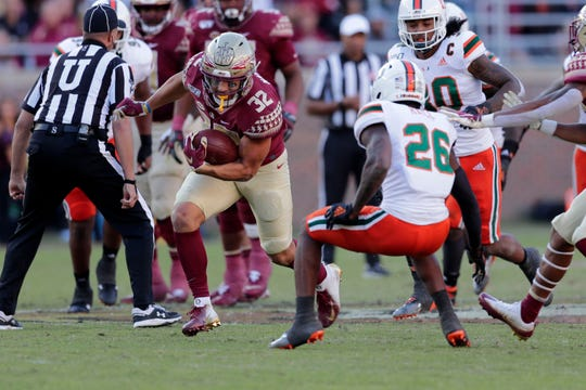 Florida State Seminoles tight end Gabe Nabers (32) runs down the field. The Seminoles lost to the Miami Hurricanes during a rivalry game on Saturday, Nov. 2, 2019.