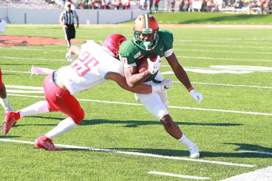 FAMU Marcus Williams looks to gain extra yards after a catch against Delaware State.