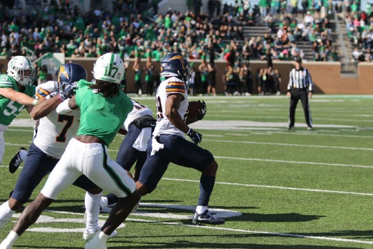 UTEP's Duron Lowe turns the corner on his 100-yard kickoff return Saturday against North Texas