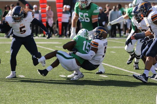 UTEP linebacker Jayson Van Hook brings down North Texas tailback Tre Siggers Saturday in Denton