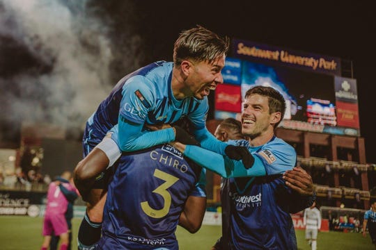Sebastian Velasquez (top) celebrates with Chiro N'Toko (3) and Drew Beckie after his goal put the El Paso Locomotive ahead 3-0 in their Western Conference semifinal against Sacramento FC