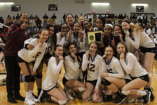 The Ossining Pride poses with the championship plaque and individual medals following their five-set comeback win against North Rockland in the Section 1 Class AA finals on Sunday, Nov. 3, 2019 at Pace University.