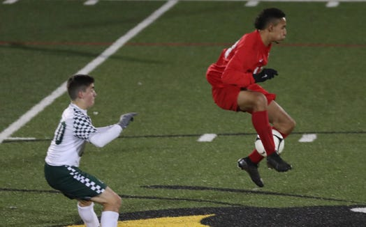 From left, Hamilton's Juan Camilo Hena Escudero (17) controls a pass against and Leffell during the Section 1 Class C championship game at Lakeland High School in Shrub Oak Nov. 2, 2019.  Hamilton won the game.