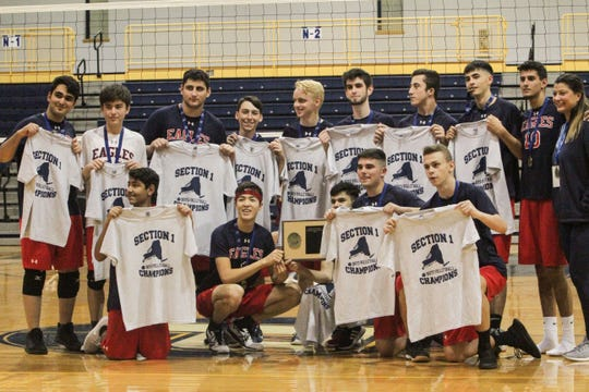 The Eastchester Eagles pose for a picture with the Section 1 Division II boys' volleyball championship plaque, and their commemorative t-shirts, after sweeping Clarkstown South in the Saturday, Nov. 2, 2019 title game.