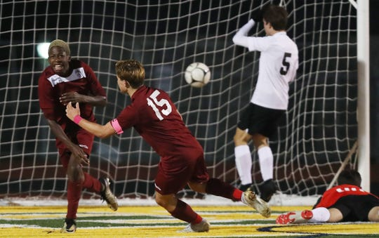 From left, Ossining's Kevon Evans (3) celebrates his goal against Mamaroneck with teammate Nolan Lenaghan (15) during the Section 1 Class AA championship game at Lakeland High School in Shrub Oak Nov. 2, 2019. Ossining won the game 2-1.
