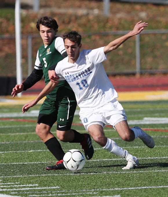 Bronxville's Luke Doukas (10) moves the ball away from Hastings'  Bryce Jacobs (5) during the Section 1 Class B championship game at Lakeland High School in Shrub Oak Nov. 2, 2019. Bronxville won the game 2-0.