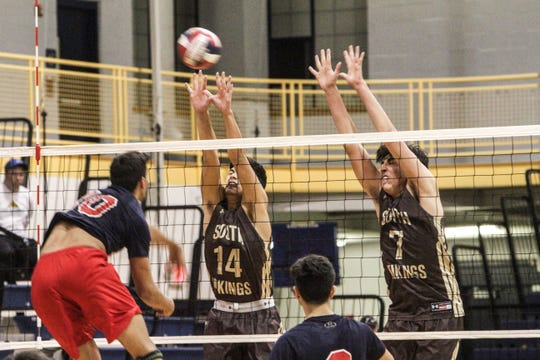 Clarkstown South's James Wirchansky (7) and Joseph Michalopoulos (14) attempt to block a spike by Eastchester's Rob Doria (10) in the Section 1 Division II boys volleyball championship game on Saturday, Nov. 2, 2019.